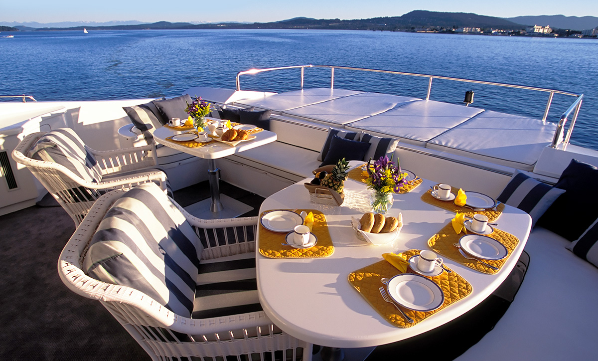 Breakfast setting on the deck of a private yacht.