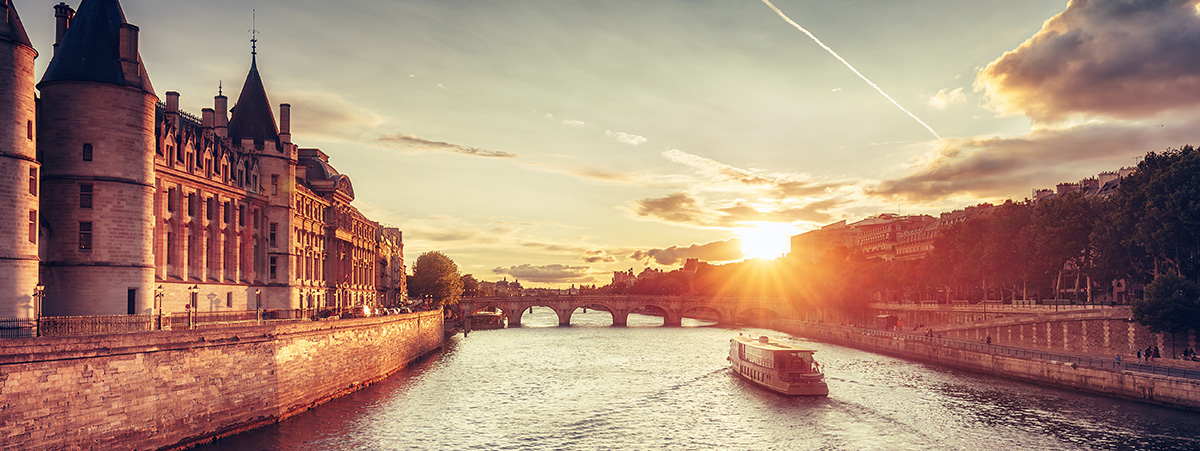 The sun setting over a european canal.